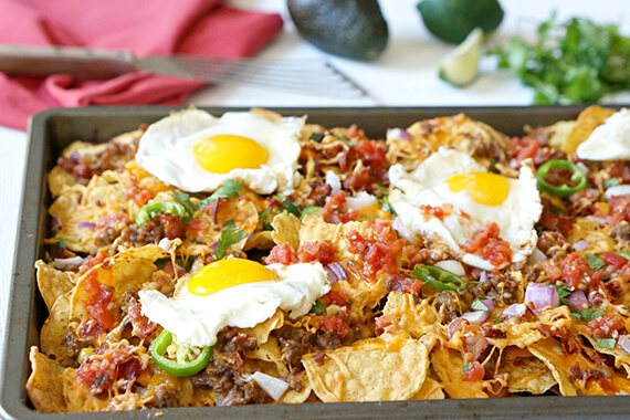 Sausage, Bacon, and Eggs Breakfast Nachos Recipe Image